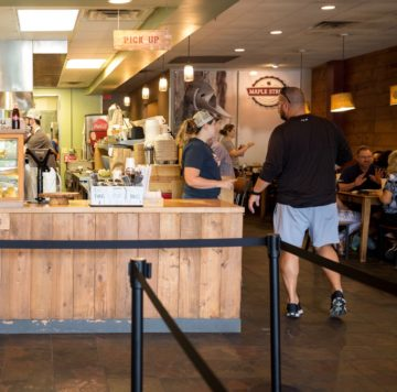 View of Hub/Service Counter and dining room at Maple Street Biscuit Company's San Marco store