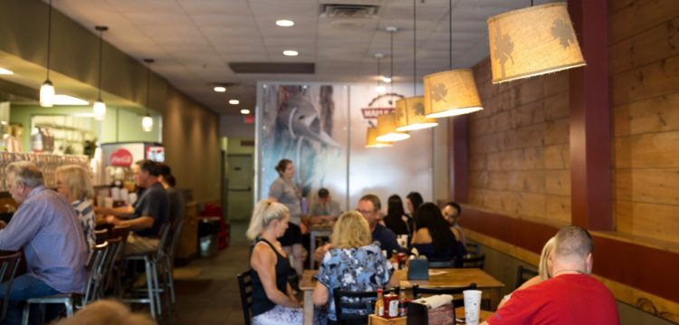 Guests enjoying their food in the dining room of Maple Street Biscuit Company's San Marco store
