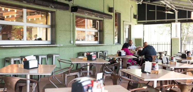 Outside dining patio at Maple Street Biscuit Company's Julington Creek store