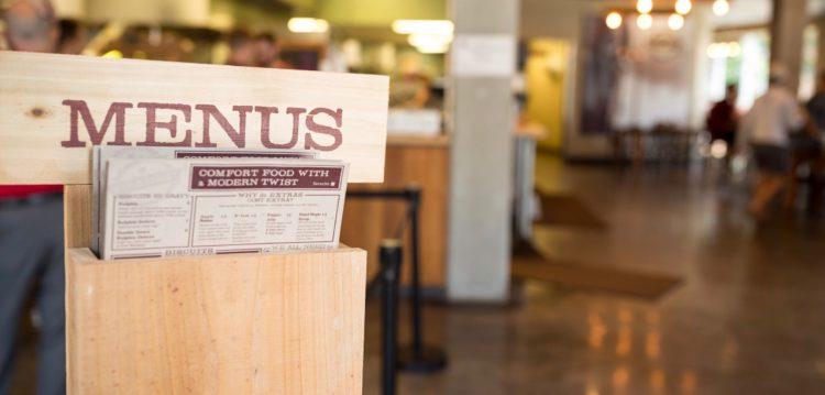 Close up photo of Menu stand and blurred interior of FSU store