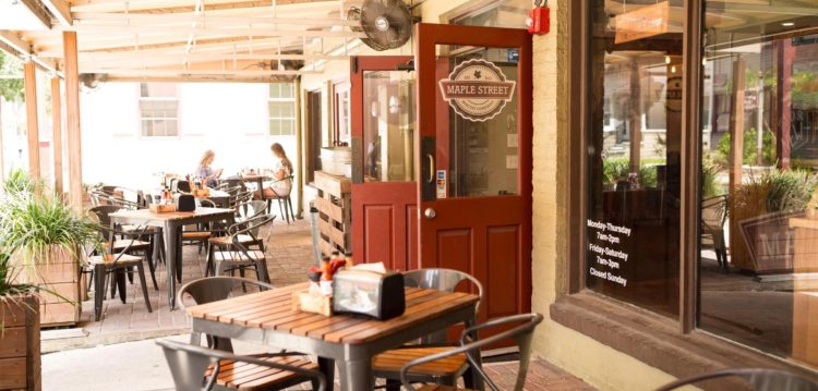 Outdoor dining patio at Maple Street Biscuit Company's Old City store