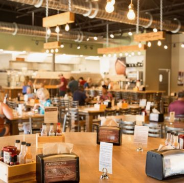 Interior view of Maple Street Biscuit's dining room featuring the community table