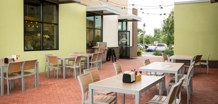 Patio dining space at Maple Street Biscuit Company's Oviedo store