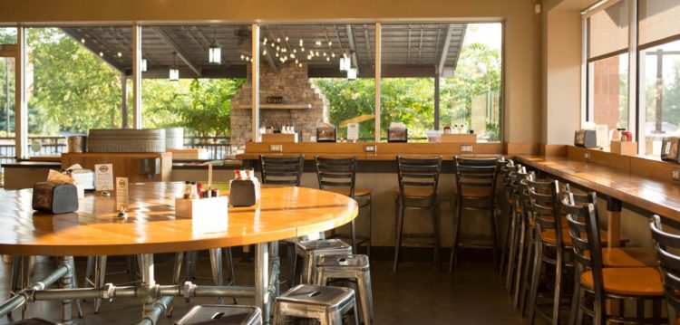 Round community table at Maple Street Biscuit Company's Woodstock GA store