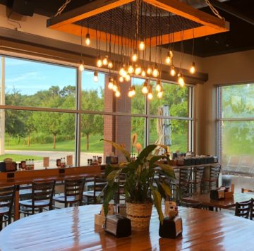 Community table in dining room at Maple Street Biscuit Company's Point Meadows store