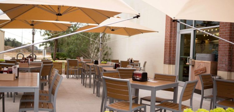View of exterior dining patio at Maple Street Biscuit Company's Point Meadows store