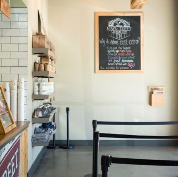 Interior photo of chalkboard next to Hub/service counter at Maple Street Biscuit's Johnson City store