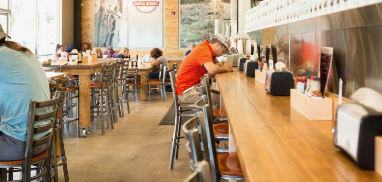 Man at counter in Maple Street Biscuit's Johnson City store