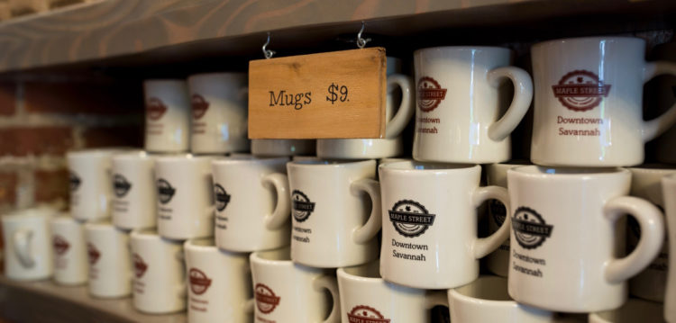 Display of coffee mugs at the Maple Street Downtown Savannah location