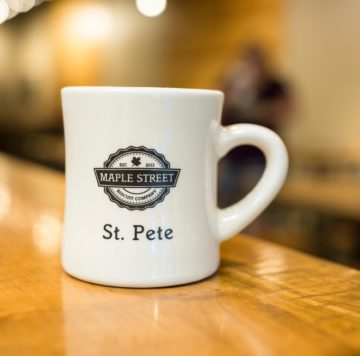 Coffee mug with Maple Street Biscuit's logo & St. Pete store name on it