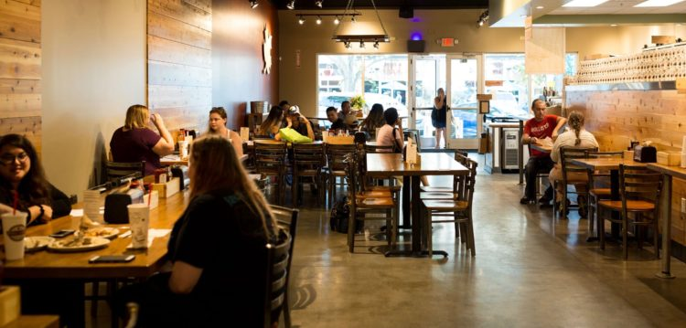 Interior view of dining room at Maple Street Biscuit Company's St. Pete store