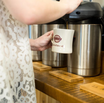 photo of guest getting coffee from the coffee bar at the Maple Street Carrollwood location