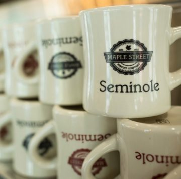 coffee mugs lined up at Maple Street Biscuit Company's Seminole store