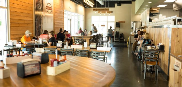 Interior view of dining room from the community table at the Maple Street Biscuit Company's Seminole store