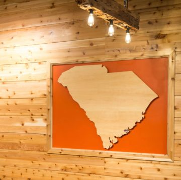 Wooden cutout of the State of South Carolina at Maple Street Biscuit's James Island store