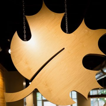 Wooden maple leaf display at Maple Street Biscuit Company's Tioga store