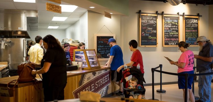 Guests waiting to place orders at the Hub/Service Counter at Maple Street Biscuit Company's Tioga store