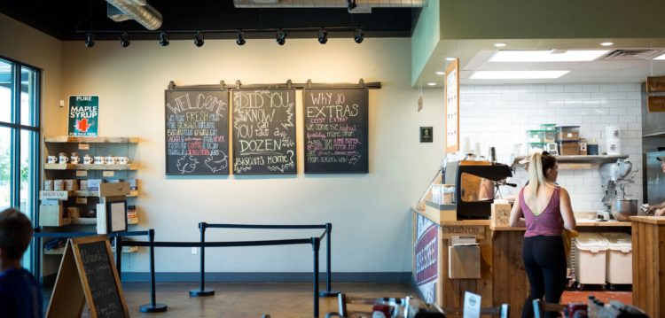 Interior photo of three message boards near the Hub/service counter at Maple Street Biscuit's Fleming Island store
