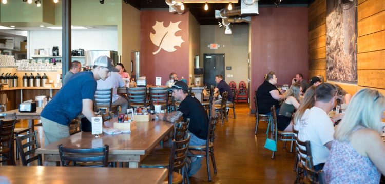 Interior photo of dining room at Maple Street Biscuit's Fleming Island store
