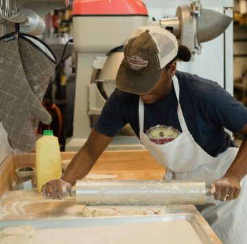 Rolling out biscuit dough at Maple Street Biscuit Company's Concord store
