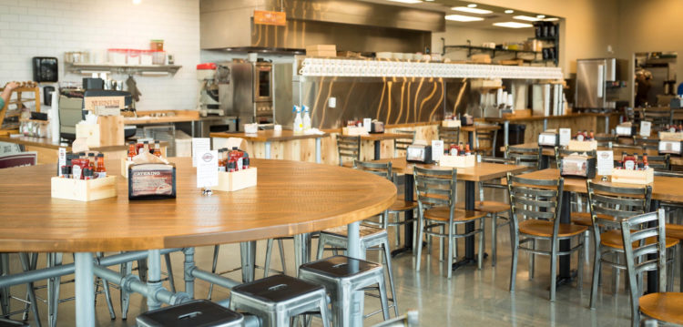 Interior photo of Maple Street Concord location featuring community table